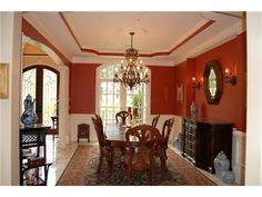The tray ceiling and the mirror makes the small dining room appear larger!
