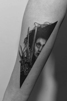 Edward Scissorhands tattoo on the inner forearm.