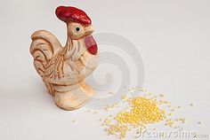 Statue of a rooster on a white background. ceramic