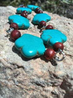 Bracelet turquoise chained flowerbrown by Jewelrymadebynature, €37.00