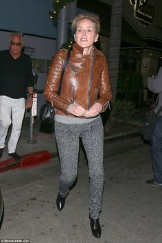 She has a look: The Sliver star had on a brown leather motorcycle jacket with zippers in t...