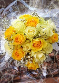 """This sunny bloom is sure to add some cheer to your """"I Dos."""" Bright and beautiful, these yellow roses are the perfect way for brides to add a pop of color to their special day."""