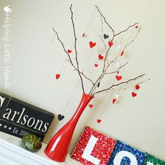 Need a red vase? Have an empty wine bottle? Get creative... spray paint a wine bottle (spray first coat lightly to avoid streaks, then add second coat after first coat dries). Fill bottles with branches  like the picture above & decorate per holiday. #ValentinesTree