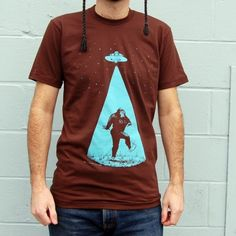 Bigfoot abducted by aliens. Now the truth is known!  I'm just kind of wondering what this guy is wearing on his head.  Lol!
