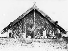 Photograph of Nga Tau e Waru meeting house at Te Ore Ore marae, Masterton district, with a group of Maori standing in the porch of the house; Abstract Sculpture, Wood Sculpture, Bronze Sculpture, Maori Tribe, Polynesian People, Maori People, Workshop Plans, Maori Designs, Maori Art