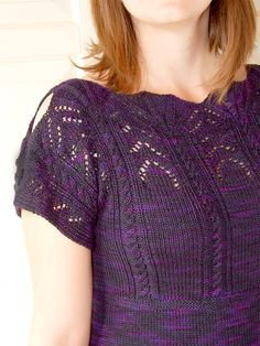 Free Knitting Pattern for Kirsche Top - It's all about the extraordinary details in this pullover tee including lace, cables, a shell lace neckline, and cutouts on the sleeves. The pattern is only one size so you will have to customize and/or read the notes on other projects for modifications. Designed by Rhona R. Fingering weight yarn.