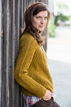 No nautically inspired collection could be complete without a garment in Fisherman's Rib. This form of brioche stitch is simple to work and creates a spongy, warm fabric. Here it's cleverly enlivened with a delicate lace motif for a subtle feminine quality that can dress up or dress down. Docklight is knit in the round …