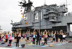 """To kick off a year-long initiative, Scripps Health and the Downtown Partnership sponsored the inaugural """"Stretch Yourself with Scripps"""" lead by Yoga One."""