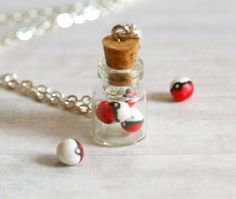 I found 'Pokeball in a jar necklace made of polymer clay miniature bottle' on Wish, check it out! mini pokeballs :3
