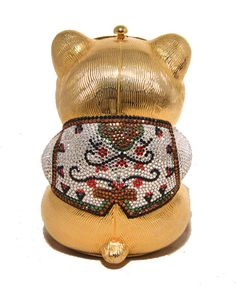 Judith Leiber Gold & Swarovski Crystal Teddy Bear Minaudiere.Stunning Judith Leiber Swarovski crystal & gold teddy bear minaudiere in excellent condition. Gold teddy bear formed exterior trimmed with multicolored swarovski crystals. Top push button closure opens to a gold leather lined interior that holds an attached hidden gold chain shoulder strap. No stains, smells, scuffs, or missing crystals.