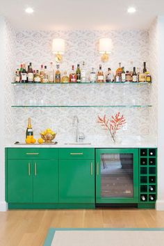 The home bar shown in the image above is stylish and eclectic, using bold colors to create this fun home wet bar.