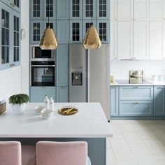 You have to see these soft blue kitchen cabinets with metallic accents and pops of rose gold. Love it! #KitchenDesign #HomeDecorIdeas @istandarddesign