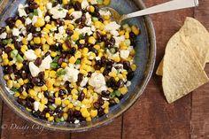 Black Bean & Feta Dip Recipe Appetizers with black beans, corn, feta cheese, green onions, red pepper, sugar, apple cider vinegar, vegetable oil, garlic, salt, pepper