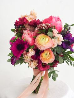 Bright bouquet with pinks, purples, and peach