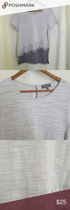 Market & Spruce Stitchfix tee gray lace asymmetric Gorgeous Market & Spruce Stitchfix short sleeve tee in textured light gray. Accented with asymmetrical pale gray lace over a dark gray silk-like hem line. Keyhole with button at the back.  Size medium. Excellent condition Market & Spruce Tops Tees - Short Sleeve