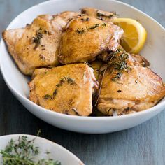 Lemon-and-Thyme Baked Chicken Thighs | Fragrant lemons fill out the delicious marinade for these easy baked chicken thighs. Easy Baked Chicken Thighs, Braised Chicken Thighs, Chicken Thigh Recipes, Cheese Stuffed Chicken, Balsamic Vinegar Chicken, Lemon Filling, Best Comfort Food, Poultry, Pheasant