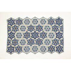 Jane has based this blanket design on Delftware pottery. The blanket is made from repeated hexagon motifs and it features a zig zag side edge.