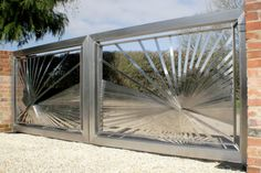 Contemporary stainless steel automated gates. Main central gates.