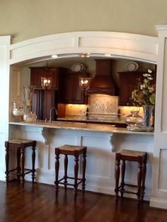 Love this kitchen with plenty of seating and open to other areas of the home.