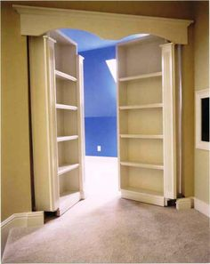 Bookcases mounted on French doors lead to secret space.