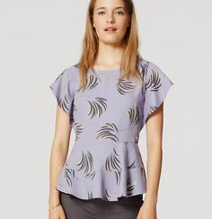 With refreshingly modern willows, flutter sleeves and a peplum hem, this tee styled piece is worthy of a swoon. Round neck. Flutter cap sleeves. Peplum waist. Back zip.