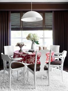 Add character and save money by painting and recovering mismatched dining chairs in the same color and fabric. Design by Brian Patrick Flynn