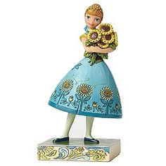 Spring has sprung! This delightfully hand-painted Anna figurine from the endearing Disney Traditions collection features the cheerful folk art style of Jim Shore and is sure to brighten anyone's day. Perfect for a Frozen fan.