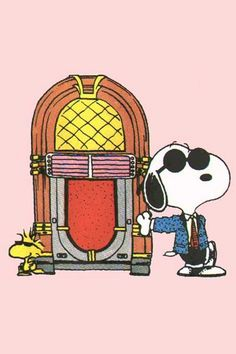 JUKE BOX:  Snoopy is leaning against a jukebox and Woodstock is standing on the other side of it.   --Peanuts Gang/Snoopy& Woodstock