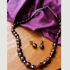 Brown / amber hand beaded jewelry set 21 inch brown amber hand beaded necklace with toggle clasp and matching earrings with sterling silver hook Handmade Jewelry