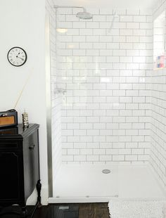 I actually like the white subway tile for our 2nd bathroom -would open up the space