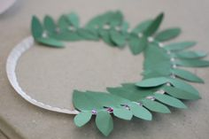 "Olympic Olive Wreath Craft - I Can Teach My Child! - - Did you know that there were absolutely no medals in the Ancient Olympics and there was only one ""winner"" (no silver or bronze)? That winner was crowned. Summer Camp Crafts, Summer Activities For Kids, Camping Crafts, Crafts For Kids, Indoor Activities, Family Activities, Summer Fun List, Summer Kids, Mardi Gras"