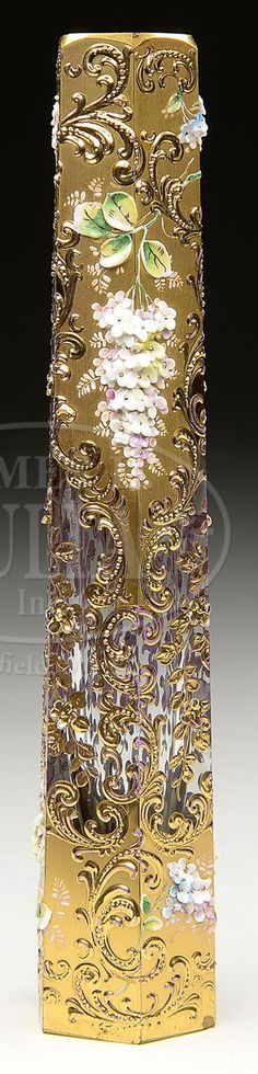 Floral Decorated Vase Has Gilded Flowers And Scrolls Surrounding The Hexagonal, Slightly Tapering Vase, Further Decorated With Delicate Applied And Layered Flowers In White, Yellow And Lilac - Made By Moser  -  James D. Julia, Inc.