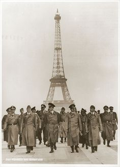 1940 Adolf Hitler and his entourage pose in front of the Eiffel Tower shortly after the fall of France.