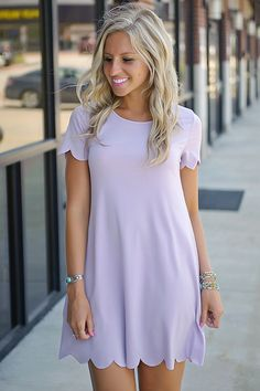 Effortlessly chic! This sweet & simple shift dress adds a fun feminine feel to your attire with scallop hems & a gorgeous lavender color! Dress it up with wedges & a cute necklace! Runs true to size.