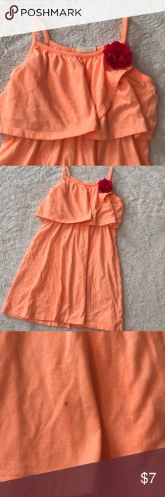 Crazy8 orange sundress with rosette flower Crazy8 orange sundress with rosette flower. Size 5-6. Has a small little dot stain seen in the picture towards the bottom on the front but not very noticeable. My daughter wore this as a swim cover up. Great condition and smoke free home crazy 8 Dresses