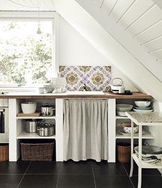 A well organized loft kitchen.