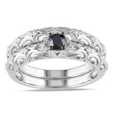 <li>Round-cut black and white diamond bridal ring set</li> <li>Sterling silver jewelry</li> <li><a href='http://www.overstock.com/downloads/pdf/2010_RingSizing.pdf'><span class='links'>Click here for ring sizing guide</span></a></li>