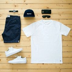 white tee, blue shorts, white shoes