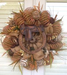 similar to Saddle and Wagon Wheel Burlap Wreath on Etsy Items similar to Saddle and Wagon Wheel Burlap Wreath on Etsy,Items similar to Saddle and Wagon Wheel Burlap Wreath on Etsy, Cotton Pickin Blessed Wreath Burlap Wreath Farmhouse Wreath Etsy Wreaths, Deco Mesh Wreaths, Fall Wreaths, Western Wreaths, Country Wreaths, Western Decor, Rustic Wreaths, Western Crafts, Wreath Crafts