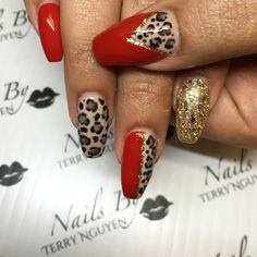 Red animal print gel nails