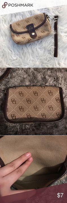 Dooney & Bourke wristlet Dooney & Bourke small brown wristlet 😍 great condition! Very practical and can fit quite a bit of stuff :) Dooney & Bourke Bags Clutches & Wristlets