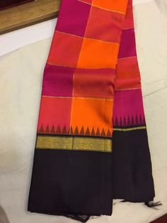 Orange and Pink toned check pattern saree with intense contrast black border.