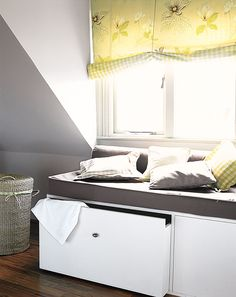 If there's no room for recessed storage, go the other way. Built-in cabinets with drawers or doors below make handy window seats. Attic Bedroom Storage, Attic Bedroom Designs, Attic Bedrooms, Bedroom Loft, Attic Renovation, Attic Remodel, Bonus Room Design, Comfy Reading Chair, Modern Bungalow Exterior
