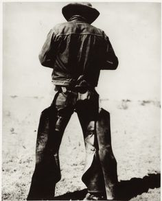 """circa 1934– """"Rear view of a man wearing chaps and spurs""""  –Photo McCormic Co., Amarillo, Texas."""
