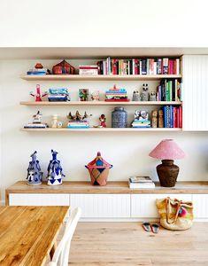 A colourful coastal cottage in Byron Bay Colourful Lounge, Colorful Decor, Oak Shelves, Floating Shelves, Ikea Storage Boxes, Making Barn Doors, Handmade Lampshades, Custom Shelving, Ikea Desk