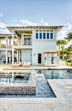 love the pool, shower, color, exterior and design of this Coastal Home..