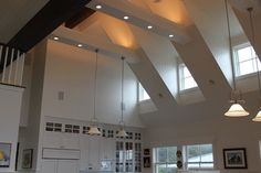 high ceiling with dormer windows and lights in supporting beams Shed Dormer, Dormer Windows, Waterfront Homes, Ceiling Height, Home Reno, Kitchen Pantry, Houzz, Beams, Track Lighting