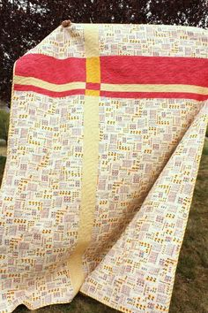 Someone cue the marching band: another UFO (unfinished object) is complete. Behold the the long-time-WIP (work in progress) Scrappy-Trip-along is finished! This quilt was started over two years ago. I finally got serious about finishing it this past January when I became determined to start tracking and finishing all those (many, many…many) WIPS. This is such a fun project – a great way to use up 2 1/2″ wide scraps or to just bust through a lot of fabric stash. Bonnie Hunter wrote the o...