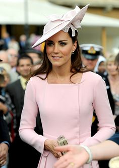 The Duchess of Cambridge attended a garden tea party at Buckingham Palace Tuesday wearing a pale pink dress she's styled before. Middleton, 30, recycled the Emilia Wickstead coat dress she wore to the Windsor Castle lunch on May 18. This time, however, she paired the dress with a matching Jane Corbett hat.