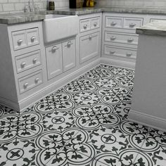 The SomerTile 9.5x9.5-inch Art Grey Porcelain Floor and Wall Tile features a gorgeous, geometric pattern in a combination of grey-green hues. Combine these tiles for a uniform design in your living ro